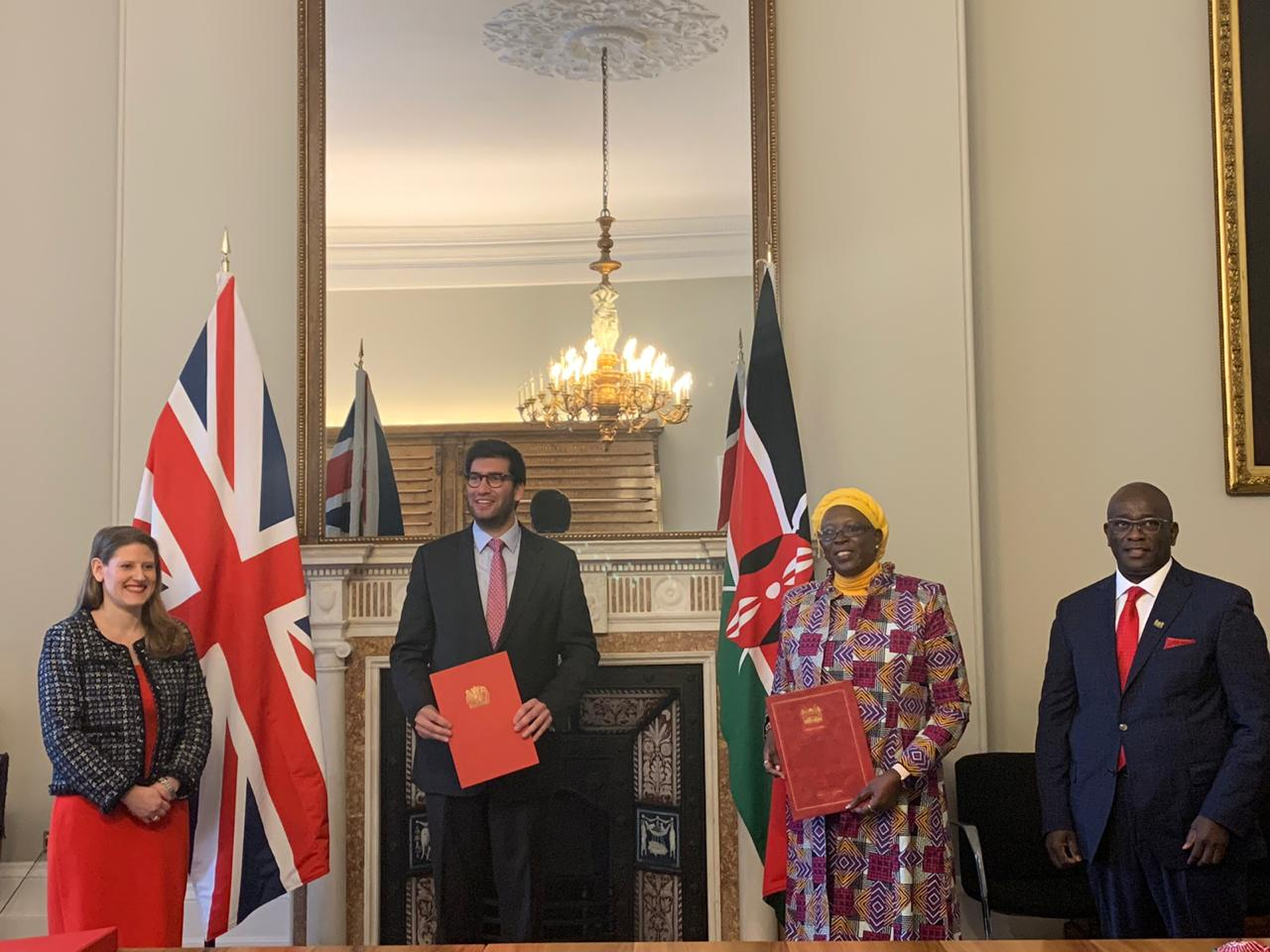 CS Betty Maina (second right), UK International Trade Minister Ranil Jayawardena (second left) and Kenya's High Commissioner to the United Kingdom Manoah Esipisu (right) after signing the pact.